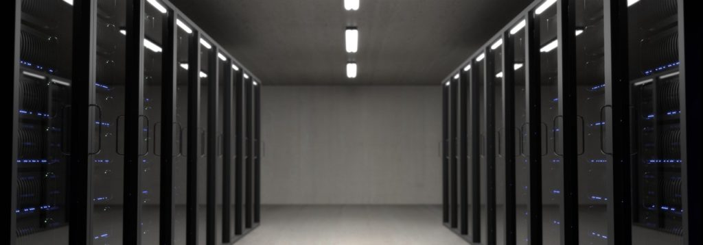Hallway lined by computer servers.
