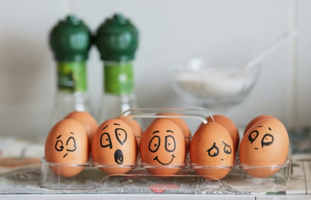 Five painted eggs expressing different emotions.